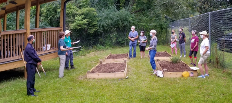 Susan and Tim prepare parishioners for a planting session