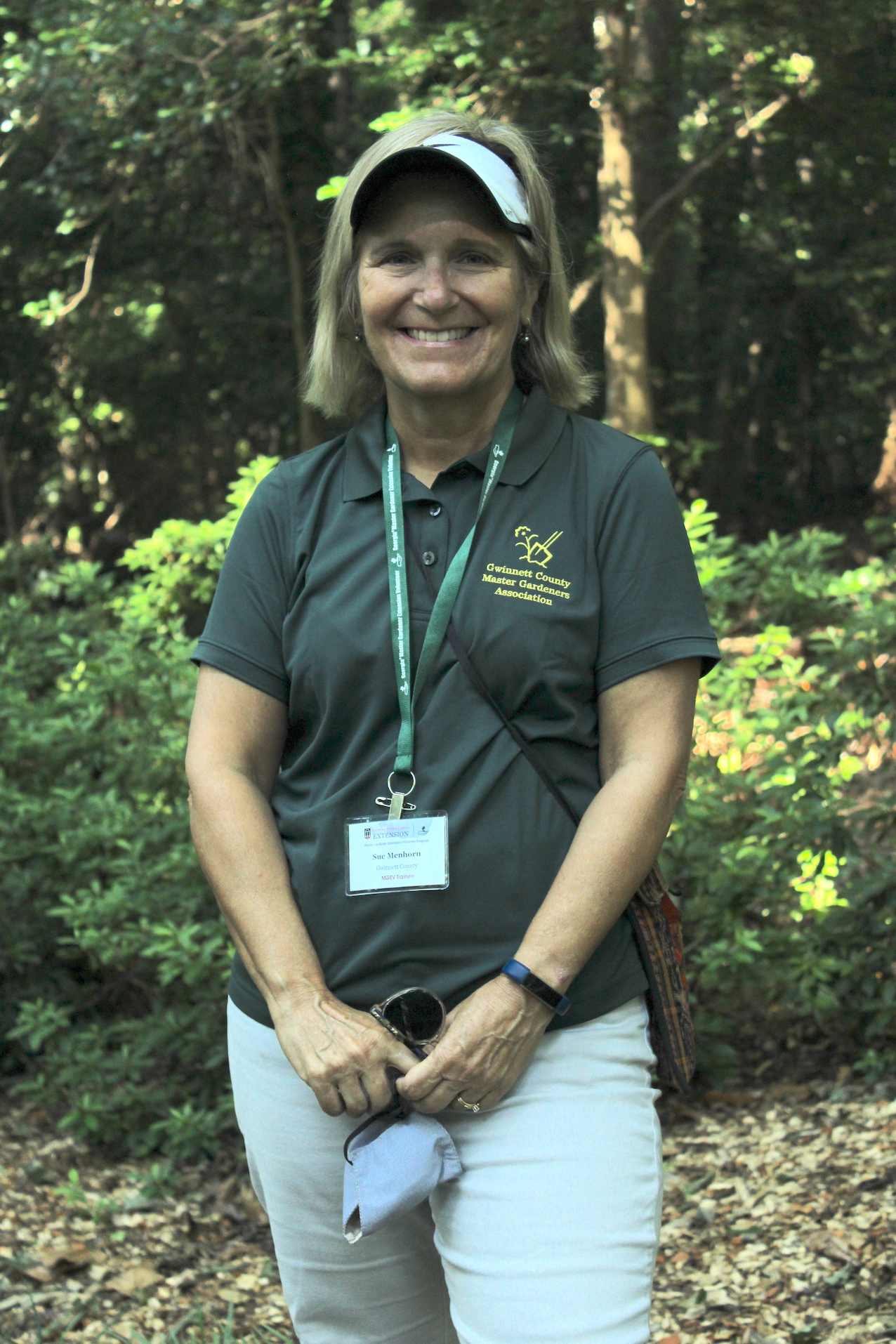 Another new master gardener warmly offers docent duties with a smile